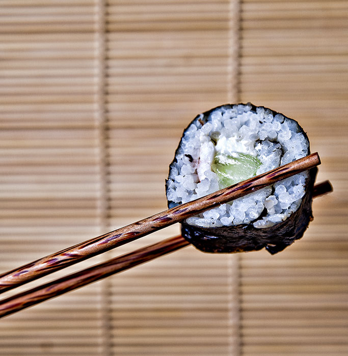 Sushi Held By Chopsticks