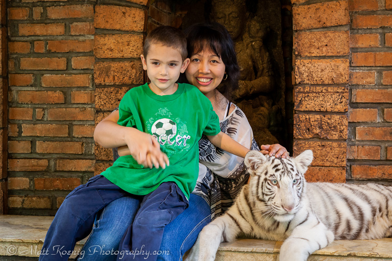 My wife and youngest son with a baby white tiger